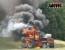 Řezačku zničily plameny – Na louku musel chemický kontejner
